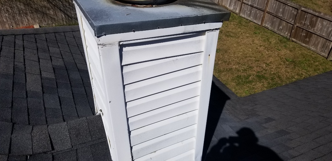 Pensacola, FL - Chimney, vinyl, wrap with ice and water shield underlayment, vinyl siding will leak we recommend removing vinyl siding and wrapping chimney with ice and water shield underlayment aka peel and stick membrane and installing vinyl siding back over after wrapping and new heavy gauge metal flashing been installed