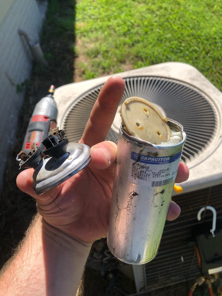 Reeds Spring, MO - Troubleshooting a no cooling call. Found outdoor unit not running. Removed service panel and found the 35/5 MFD dual run capacitor popped open and no longer usable. Replaced capacitor on system. Verified cooling operations.