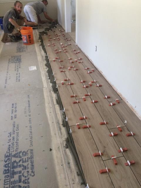 Gulf Breeze, FL - The Floor Store crew installing 8 x 36 Amazonia Porcelain Tile over half inch Durock using the clip leveling system.