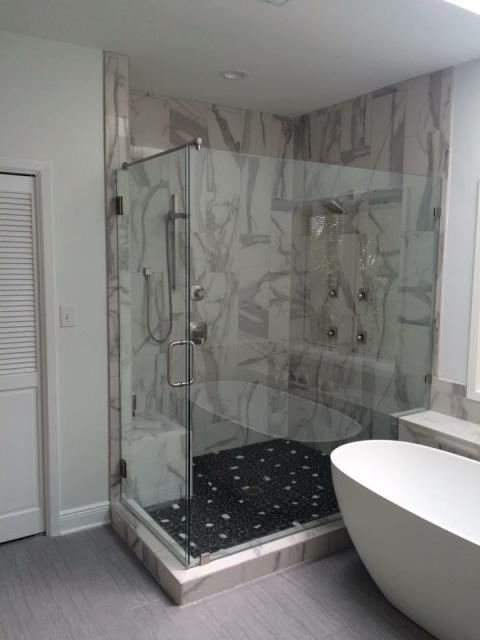 """Pensacola Beach, FL - Built 4' x 6' shower and shelf for bath tub. Wall tile is Sublime Brillo 12 x 24.  Volga Viner feature strip 12""""x12"""" sheets. Shower floor tile is Sublime Brillo Mosaic 2""""x2"""". Included recessed shelf."""