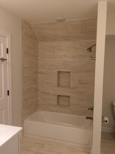 Pensacola, FL - Installed Travertine tub surround in bathroom.