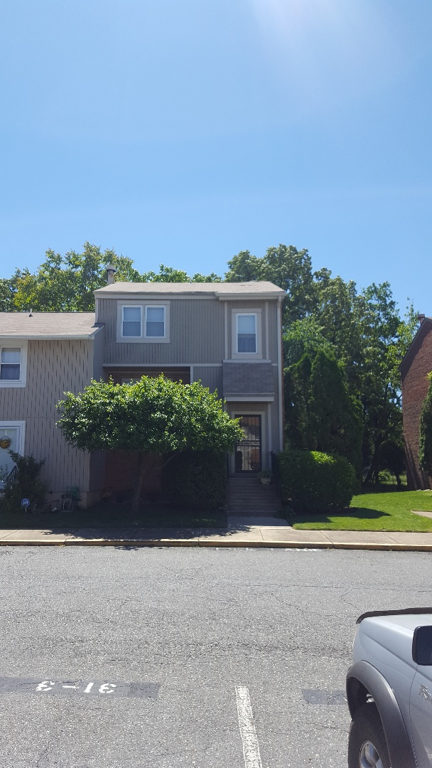 Fort Washington, MD - Missing / wind damaged shingles need to be replaced on this town house roof in Ft. Washington, MD 20744