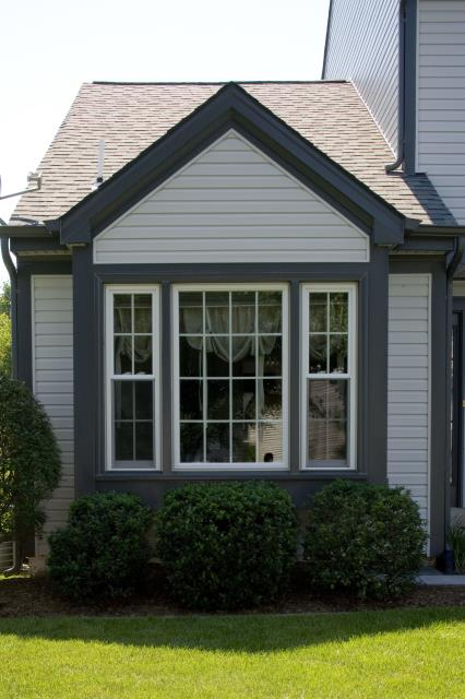 Herndon, VA - Check out these new energy efficient vinyl windows installed in Herndon, VA to replace the old, worn out wood ones!