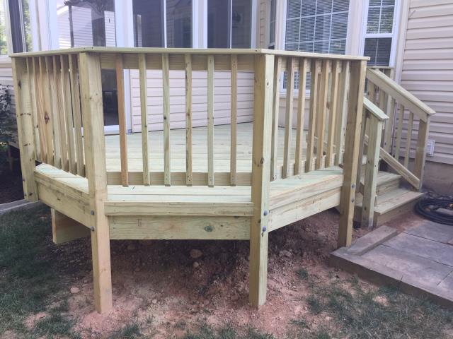 Springfield, VA - Another job done right by Nation's Choice Windows Siding Roofing! We built this deck with rails in Burke, VA!