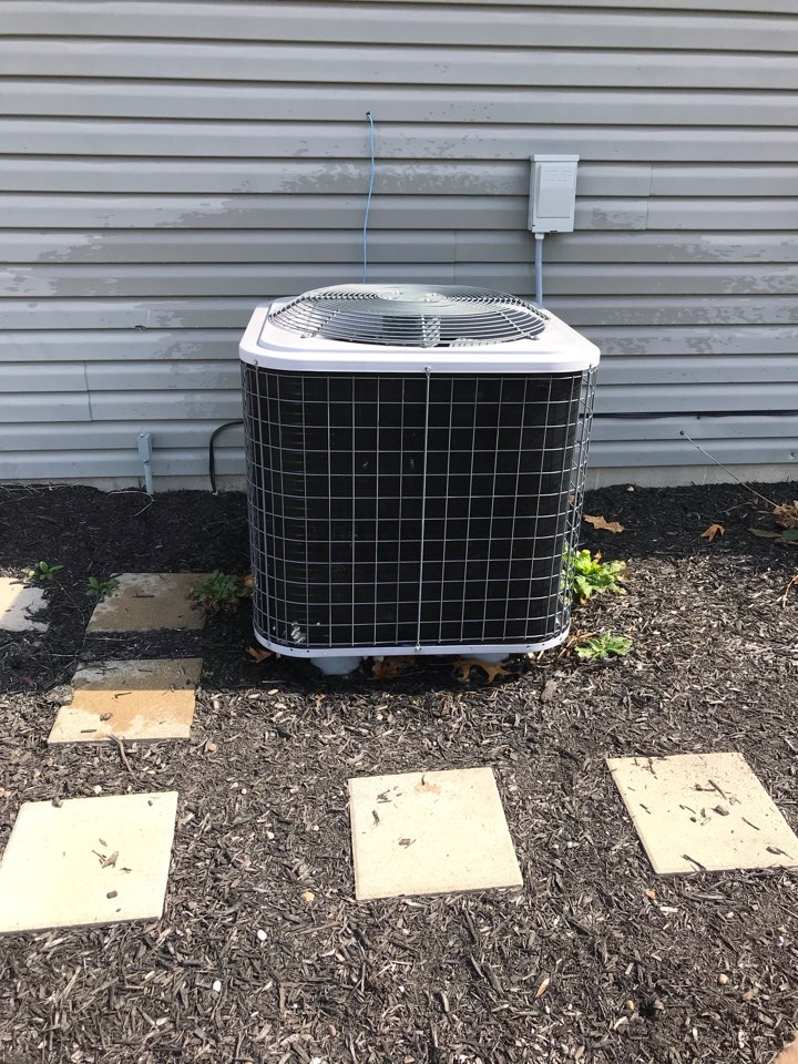 Carterville, IL - Spring maintenance on air conditioning unit