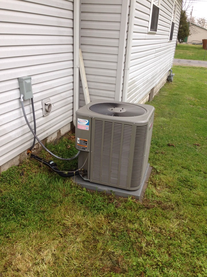 Johnston City, IL - Spring maintenance air conditioner check and cleaning. Lennox air conditioner