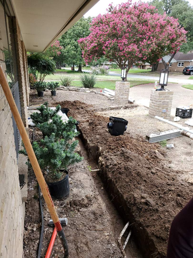 Irving, TX - Installation of a drain and sump pump.
