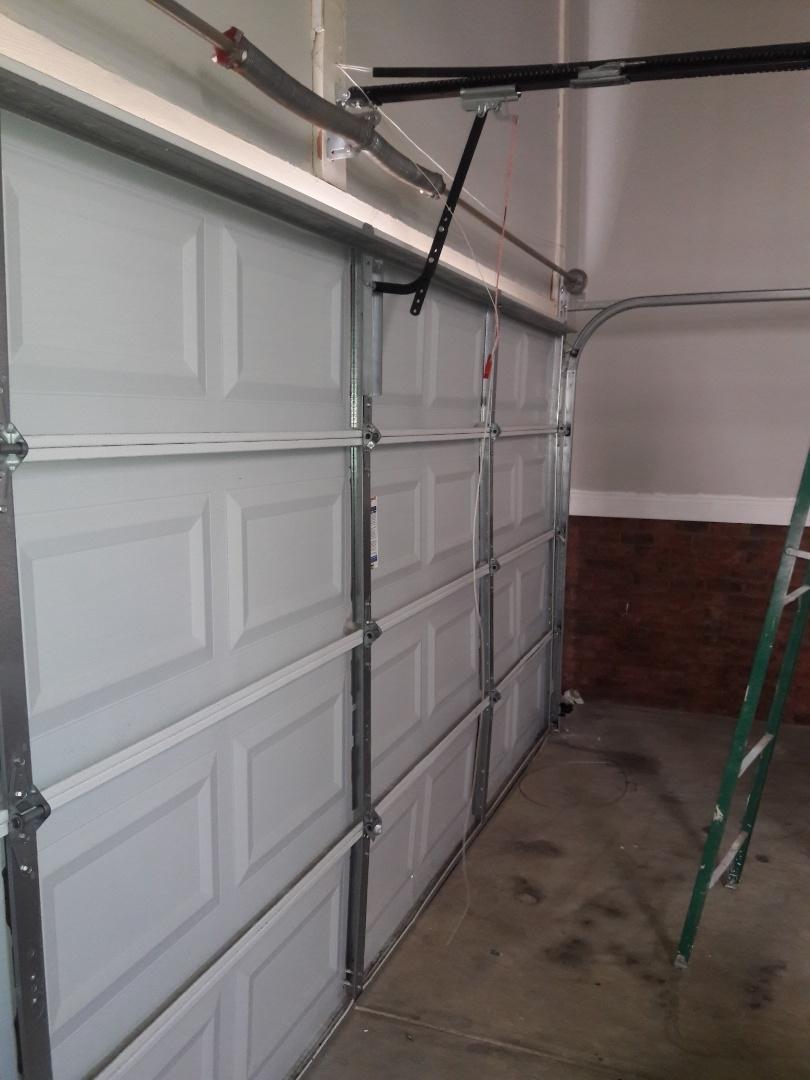 balanced door and installed operator enforcement bracket