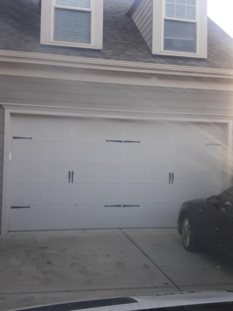 replaced rollers an balanced door