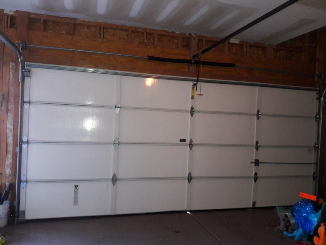Fort Mill, SC - put door back on track and replaced rollers