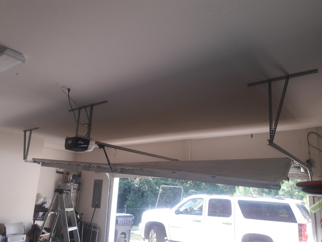 Matthews, NC - put door back on track and balanced, also replaced bottom rollers