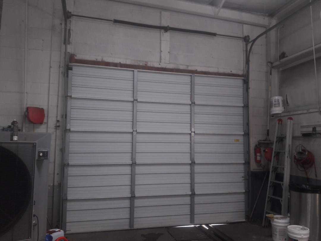 Mooresville, NC - reattached cable and balanced door
