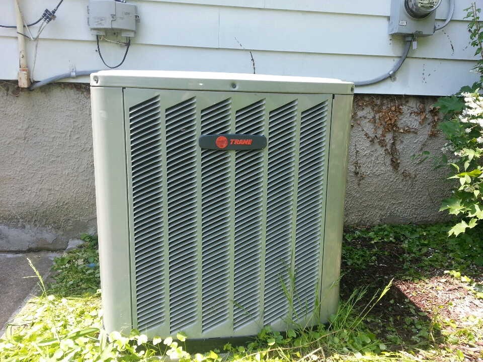 Baltimore, MD - Air conditioner service. Replacement of fan motor and capacitor in AC.