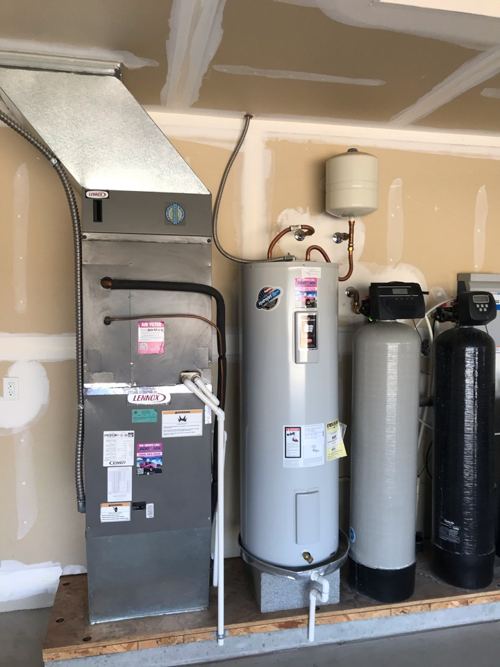 Replacing old Lennox furnace and air conditioner with an Amana air handler and heat pump, 50 gal electric water heater, and water softener and conditioner