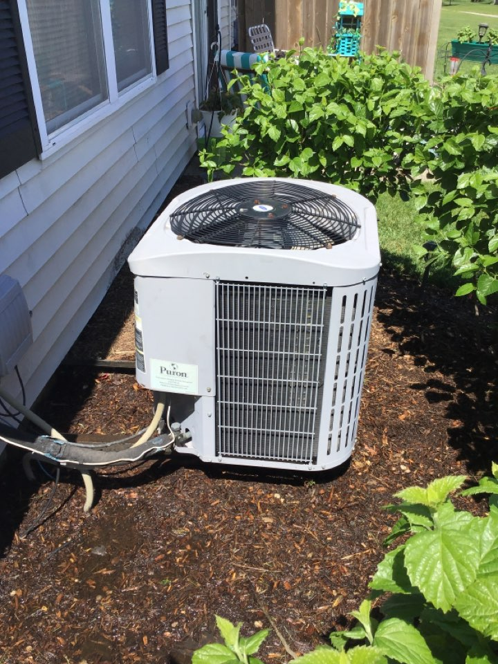 Oswego, IL - 15 year old carrier ac. This system has had leaks for the past two summer seasons. Last year easy seal was used to prevent the refrigerant leak. After checking the charge this season everything was sealed and looking good.