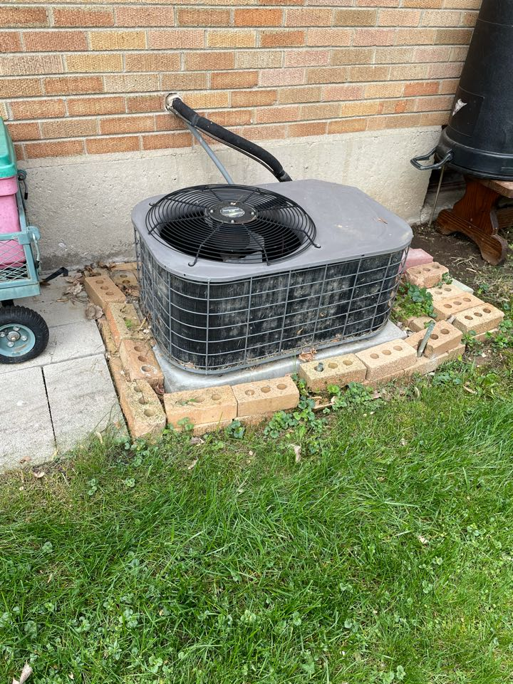 Oswego, IL - Doing a preventative maintenance on a Unitary Products A/C unit that is 60 years old.