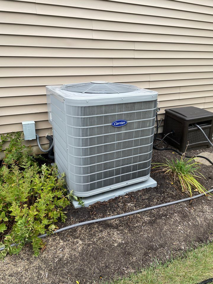 Aurora, IL - Doing a preventative maintenance on a 2 year old Carrier A/C unit in Aurora.