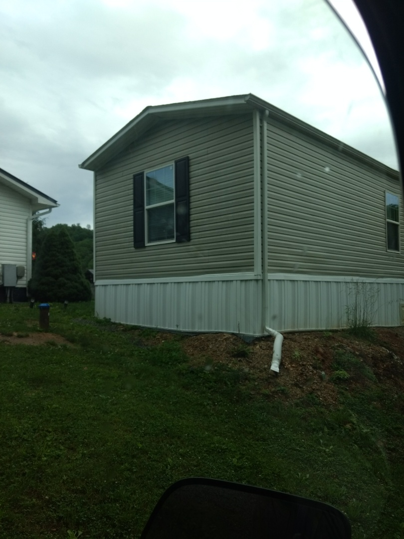 Kingsport, TN - We are giving an estimate to build a covered deck off this mobile home.
