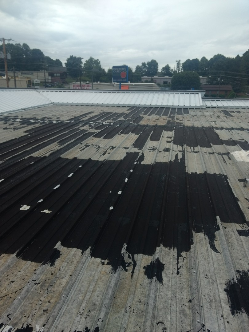 Johnson City, TN - Inspecting a roof today. The Metal Roofing needs replaced on this commercial building. We will give the buyer a free estimate. We work with area realtors to put new roofs on home that are being purchased. No down payment needed, just put the money in escrow and pay us when you close on your new home or commercial building.