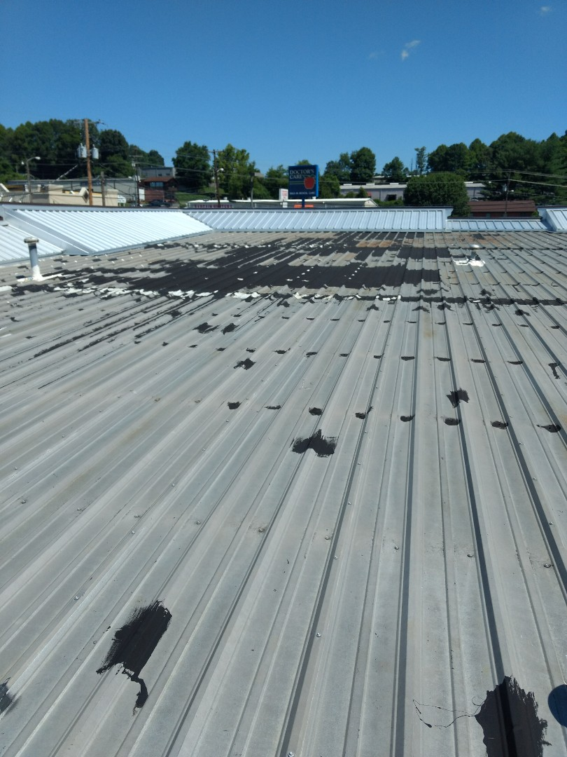 Johnson City, TN - Fixing a leak on this metal roof today. We do all types of repairs and installations, metal, EPDM, rubber, shingles and TPO.