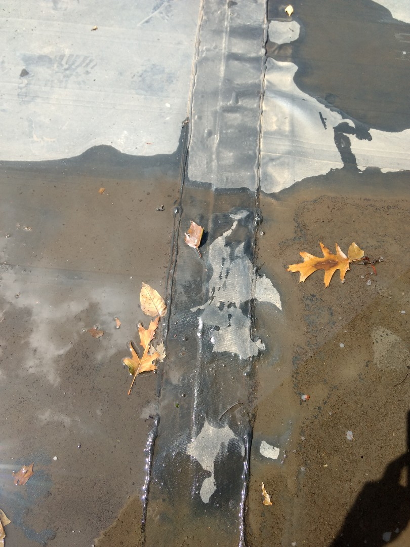 Kingsport, TN - Leaking on EPDM Roof. Clean and flash laps and corners