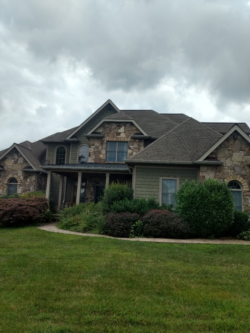 Johnson City, TN - Metal Roofing Repair at wall flashing. Also shingle repair at roof transition in rear of home