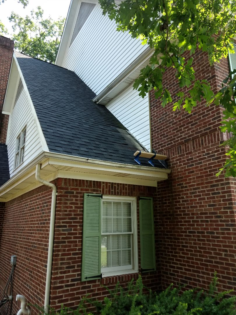 Kingsport, TN - Tear out leaking shingles on wall. Seal all step flashing and install new oc Oakridge shingles