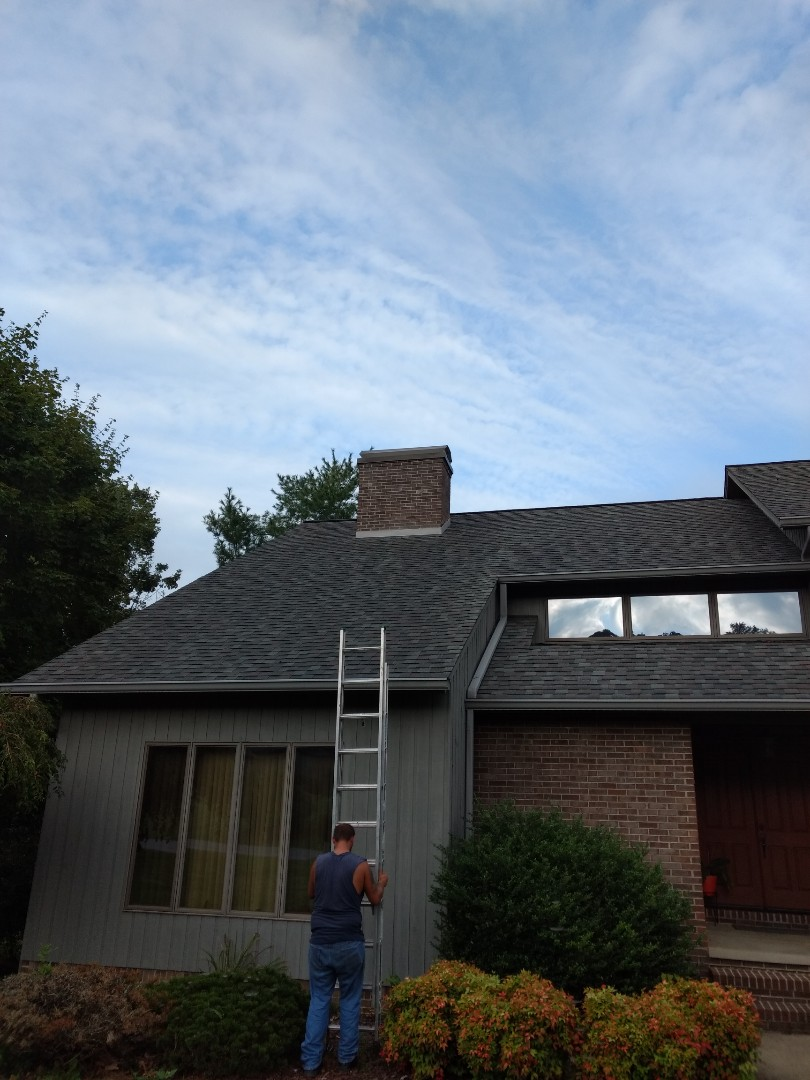 Blountville, TN - Doing a repair today. We are removing the old shingles from around the chimney and cricket area then installing new flashing and counter flashing before adding new shingles.