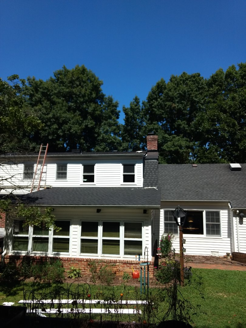 Bristol, TN - Install new GAF shingles on low-pitched roof and upper section. Flash and counter flash chimney