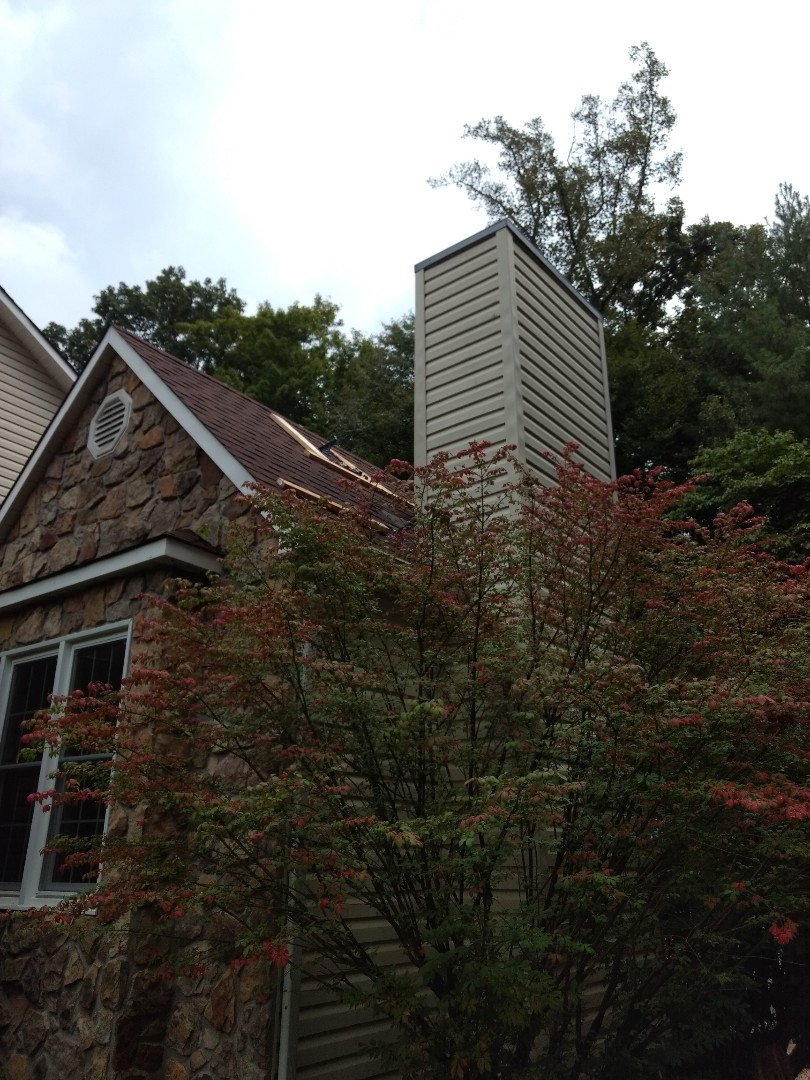 Unicoi, TN - Installing cricket behind leaking chimney to divert water and stop leaking