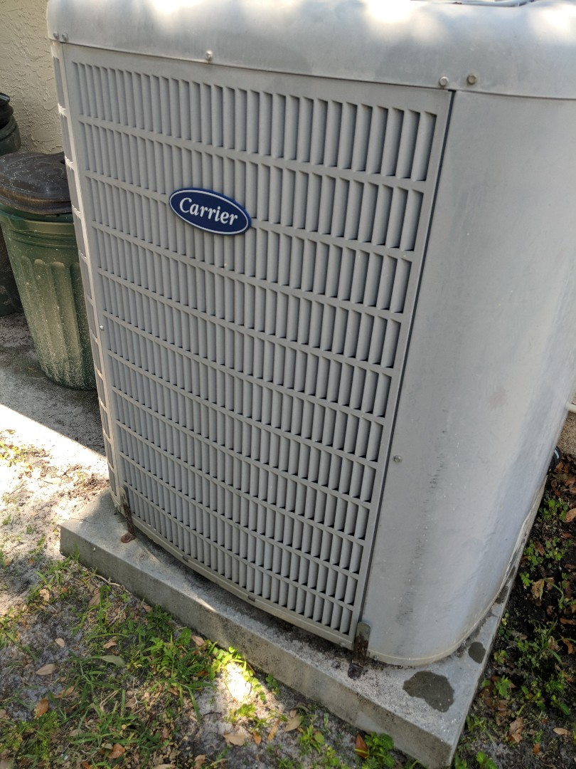 Hudson, FL - Clean and flush drain line on Carrier Infinity heat pump air conditioning system in the Hudson area