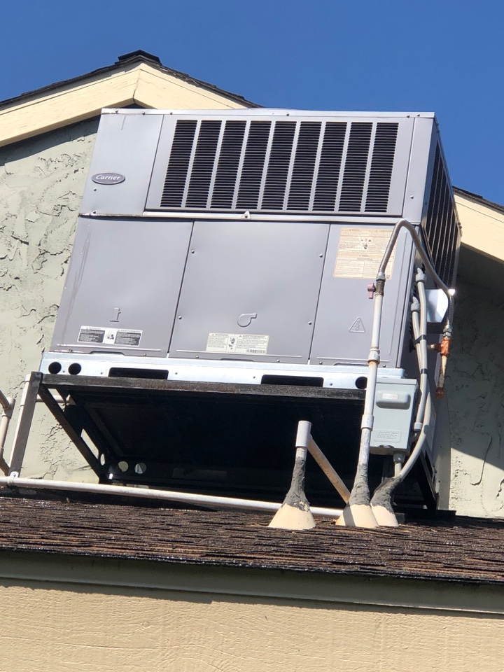 """Visalia, CA - """"Time for the spring yearly Maintenance on this 2 1/2 ton carrier dual pack unit. Electrical inspection,motor inspection, cond coil washing, system Freon check.."""""""