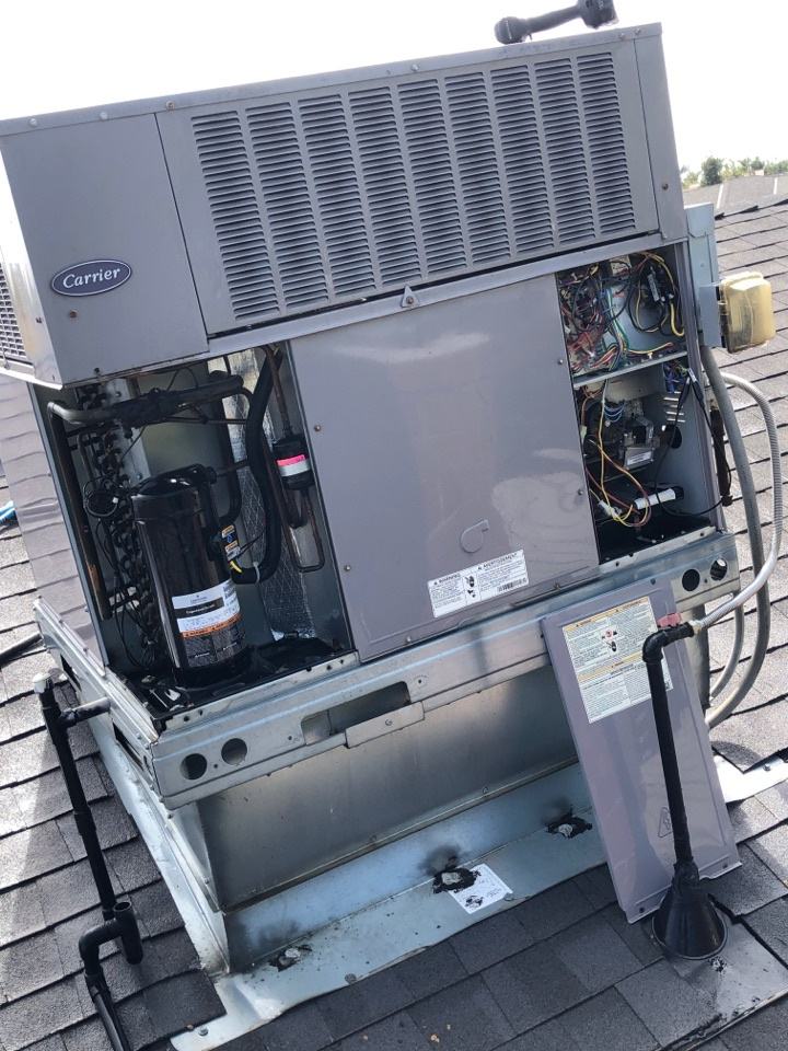 Tulare, CA - Maintaining a 3.5 carrier dual pack unit . Checking compressor compartment an electrical compartment for any issues.