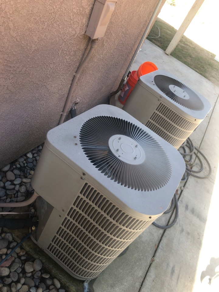 Visalia, CA - Servicing two Goodman Condenser units found on low on Freon R22 getting the units up an running for the hot summer days