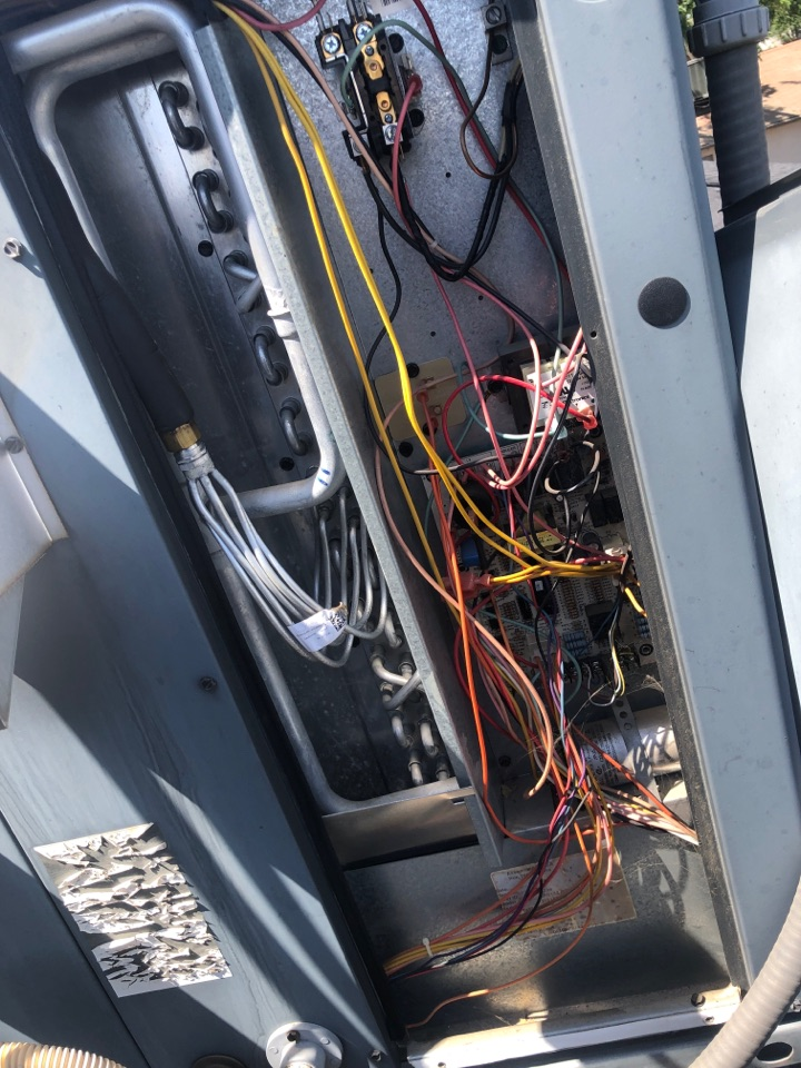 Visalia, CA - Inspection on electrical compartment during an AC maintenance getting ready for the hot summer days
