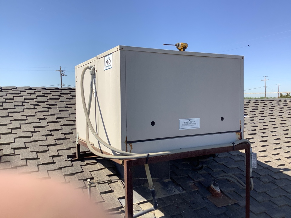 Visalia, CA - Preforming a summer maintenance service on two package units and two  swamp coolers, got to be prepared for a hot summer. Getting your AC serviced regularly will help prevent unnecessary damage and higher electricity bills.