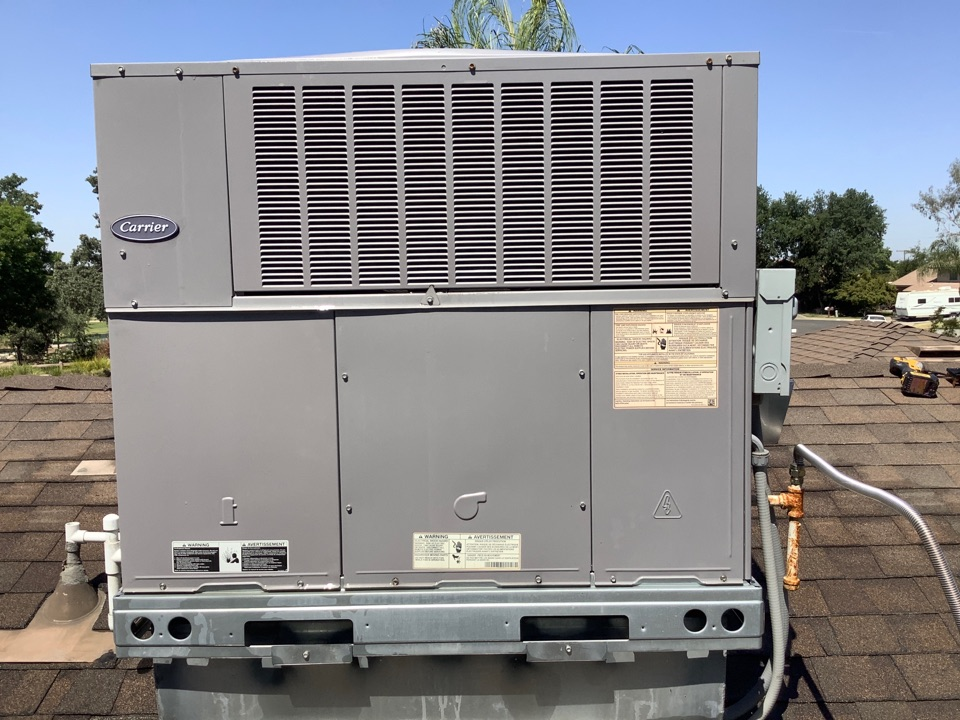 Visalia, CA - Summer maintenance service on a Carrier package unit. Washed condenser coils dusted and inspected electrical wires and connections, insured motors and refrigerant pressures were good. Keeping up on maintenance can reduce costs overall on energy consumption and costly repairs.