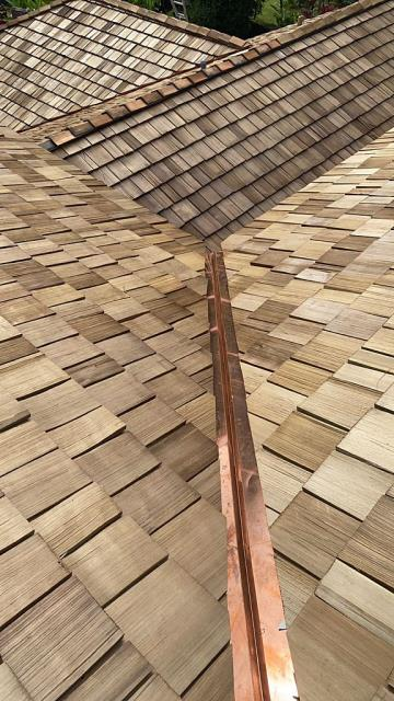 Kailua, HI - This was a beautiful roof transformation from Shingles to Gorgeous Cedar Wooden Shake with Copper finish. We are so happy to see our customers happy.