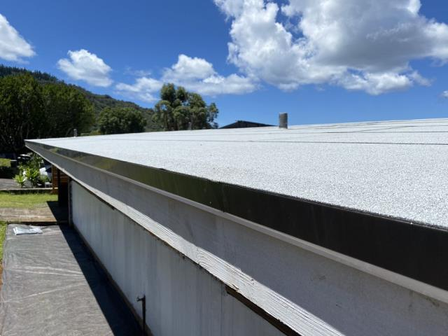 Honolulu, HI - What a great transformation on this low pitch roof. Looks great with this light colored Cap Sheet over this Roofing project. Definitely this Roof will be waterproofed for seasons to come.