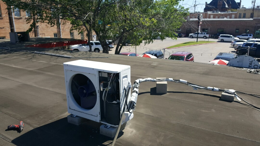 Waxahachie, TX - Checking mini split hvac systems for Pop's Burgers. Make sure you system is summer ready with a 79.95 system tune up!