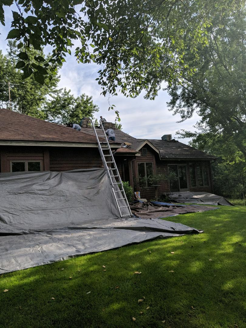 River Falls, WI - Shingling roof with asphalt certainteed landmark shingles, burnt sienna