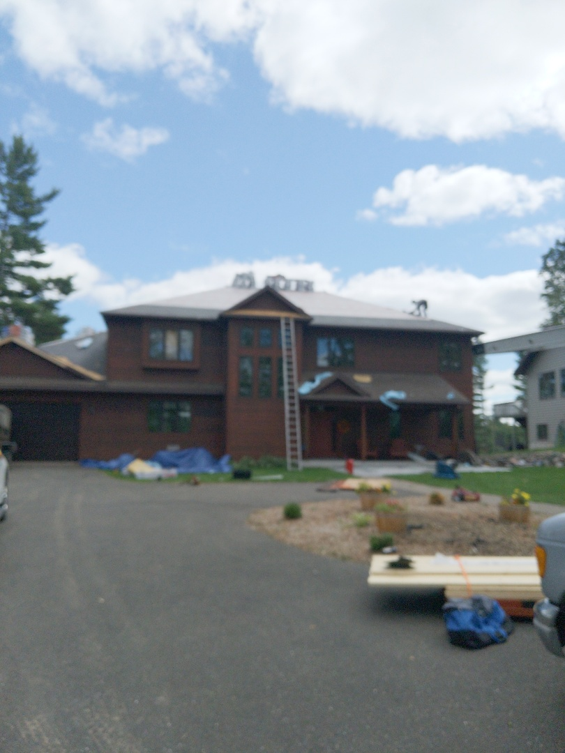 Turtle Lake, WI - InstallIng certainteed Northgate asphalt and rubberized shingles