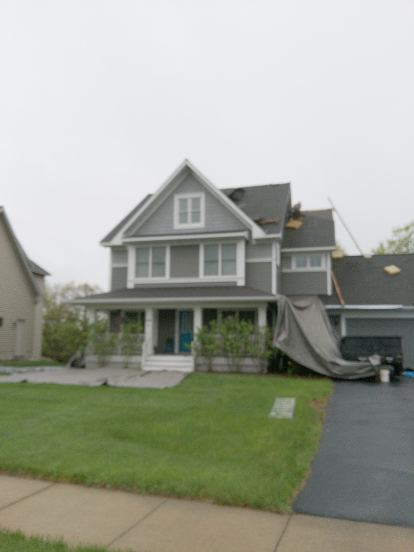 River Falls, WI - Roof installation certainteed landmark moire black with ridge venting