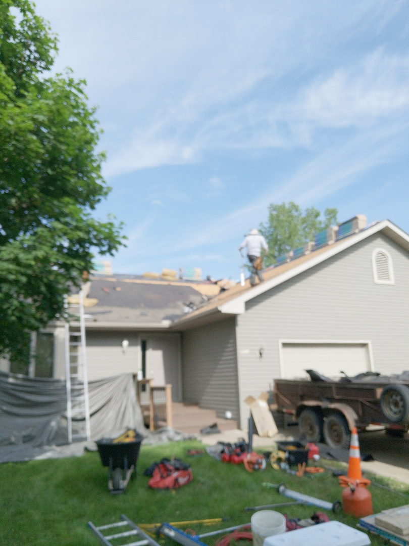 River Falls, WI - Roofing town home with certainTeed landmark weathered wood asphalt shingles.