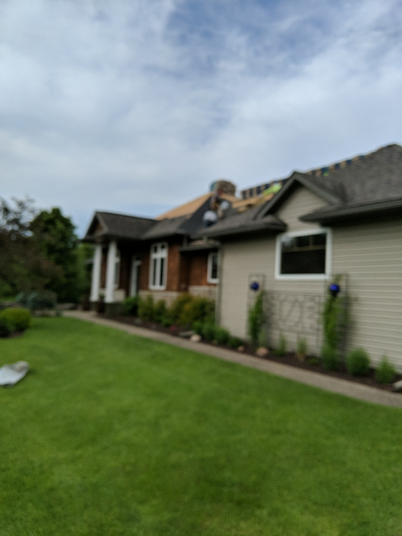 River Falls, WI - Roofing home with certainTeed landmark asphalt shingles color weathered wood