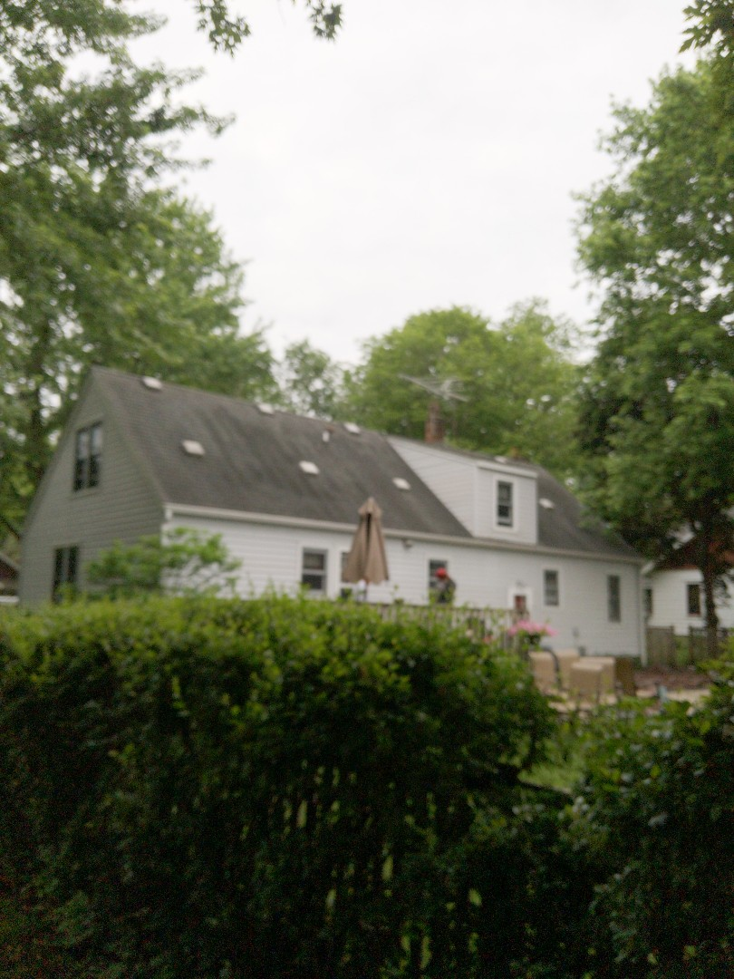 River Falls, WI - Roofing home and detached garage with certainTeed landmark asphalt shingles