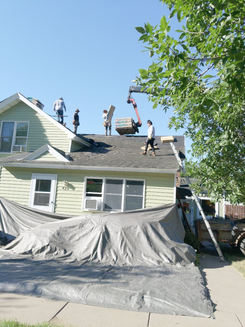 River Falls, WI - Installing asphalt roofing certainteed landmark hunter green shingles.  With chimney flashing