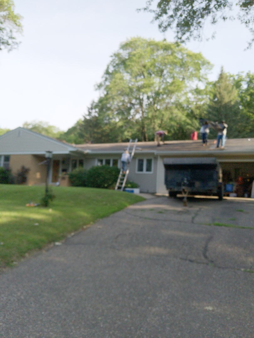 River Falls, WI - Installing asphalt roofing landmark buy CertainTeed burnt sienna with chimney flashing and new ridge vent
