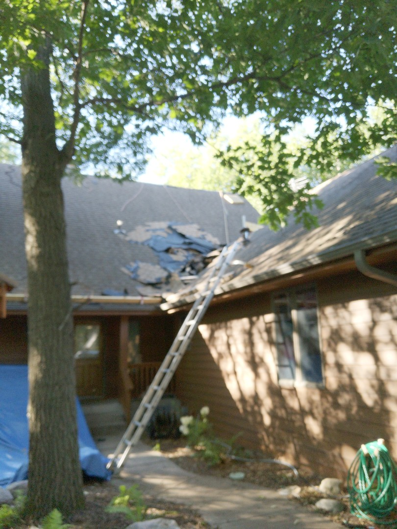 Hudson, WI - Roofing home with malarkey vista and rubberised asphalt shingles. Antique brown. I mpact resistant class 3 rated