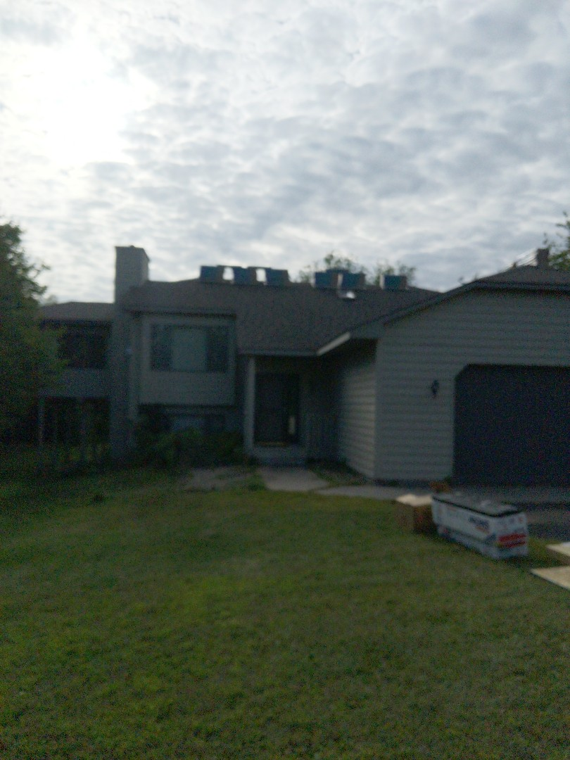 River Falls, WI - Installing CertainTeed landmark asphalt shingles including ridge venting color weathered wood